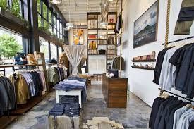 Interior Store Design And Layout Ropes From The Ceiling Stacked Wood Canvas Dividers Metal