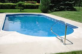decor small inground pool with green grass and stone floor for