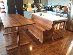 custom kitchen island with adjoined storage bench bay area