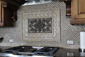 kitchen backsplash with bronze medallion and silver glass accents