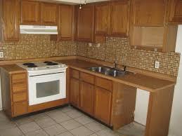 adhesive backsplash tiles for kitchen using vinyl floor tile kitchen backsplash morespoons 8ec7e9a18d65