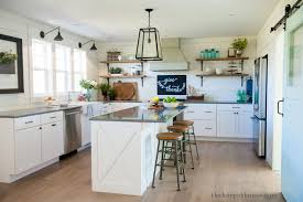 our farmhouse kitchen reveal the harper house sharing our fixer upper inspired farmhouse kitchen reveal featuring white shaker cabinets white oak floors
