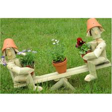 wooden garden flowerpot on a seesaw