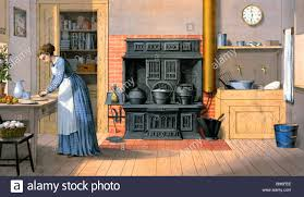 old fashioned kitchen woman working in an old fashioned kitchen 1875 stock photo