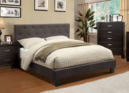 bedroom bedding and upholstered bed frame with chest of drawers