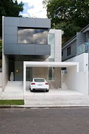 small house with garage minimalist house architecture with black facade design color