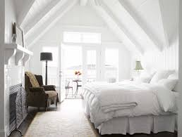 black and white bedroom white wooden bed having brown bed sheet