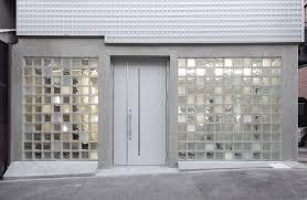 glass blocks create multi tonal facade for antiques showroom by jun