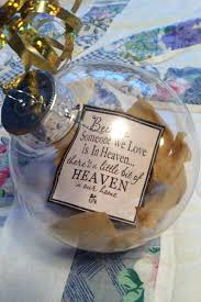 the ornament with big terry s flowers from the funeral and a quote