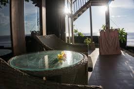 wooden cliff bungalow with terrace overlooking wonderful ocean