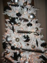white tree with black silver and gun metal colored