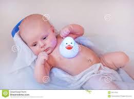 baby boy taking bath in bathtub stock photos image 28277693