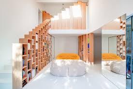 custom stepped bookshelves steal the spotlight inside this posh