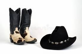 boots hair cow hide cowboy boots and black hat with conchos stock image