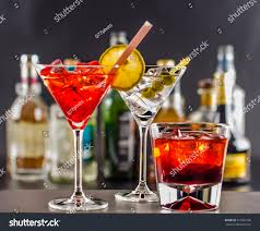 holiday cocktails background colorful drink on background bottles original stock photo