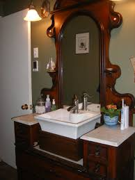 old wooden office desk used as a bathroom sink and vanity