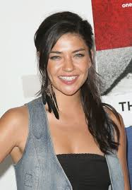 one feather earring seems szohr is trying a new ponytail on one side feather