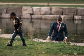 groom saves boy during wedding photo shoot