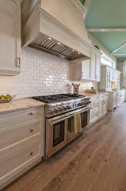 Creamy White Kitchen Cabinets Off White Kitchen Cabinet With Wire Brushed White Oak Flooring And