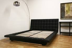 all tufted leather bed in black or white with padded frame around