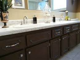 Painting Bathroom Cabinets Ideas by Painting Bathroom Cabinets Brown Restained Cabinets Makes A Huge