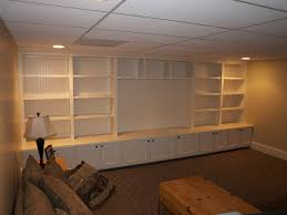 basement playroom built ins with room for a 65