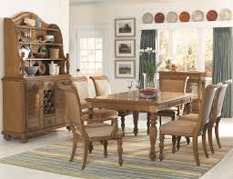 island inspired rectangular turned leg dining table with carving