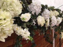wedding backdrop of flowers floral arch leaf luxe