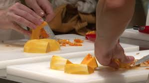 A Chef Slicing A Pumpkin by Close Up On Woman U0027s Hand Slicing Pumpkin On Cutting Board Cooking
