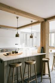 travertine countertops kitchen island with bar stools lighting