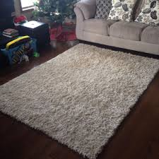 flooring beige costco rug on dark pergo flooring with white
