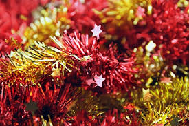 christmas tinsel background from and yellow christmas tinsel stock photo