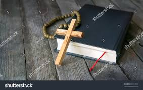 wooden crucifix wooden crucifix holy bible vintage rosary stock photo 550961875