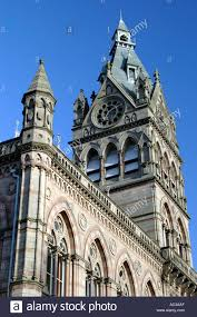 the gothic design and spires of the town hall in the historic city stock photo the gothic design and spires of the town hall in the historic city of chester in england against a blue sky