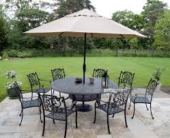 Patio Furniture Set With Umbrella - black metal patio furniture set with tan umbrella stock photo