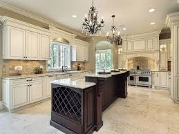 luxury style kitchen design with dark island and white cabinet
