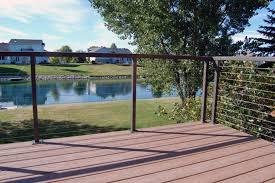 exterior casual deck design idea using black wood deck floor