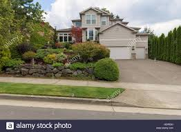 three car garage traditional house with three car garage frontyard garden lush