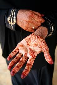 simple orange ink simple henna tattoo design image make on hand