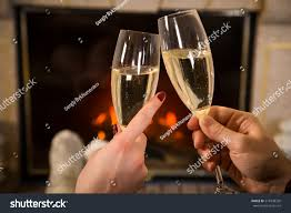 closeup couples hands glass champagne together stock photo