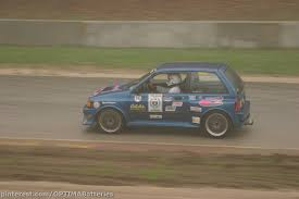 blue 1990 ford festiva shogun running in the 2003 oloa one lap