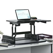 desk standing or sitting work station standing vs sitting office