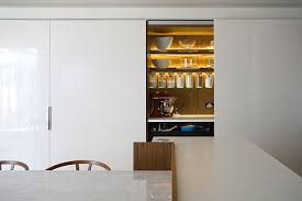 apartments gloss white cabinet precious glassware hidden light