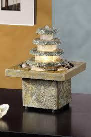 fontaine en pierre naturelle fontaine en pierre forme conique bac carré seliger spécialiste
