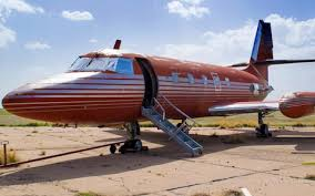 elvis plane elvis s plane to be auctioned after sitting on runway for 30 years