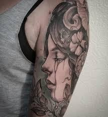 art nouveau woman crying black and grey color arm tattoo by