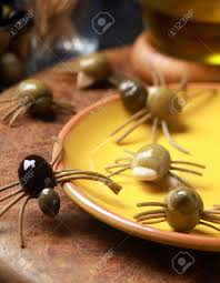 scary creepy halloween spider snacks served at a festive party