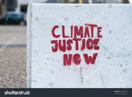 climate justice now sign painted on stock photo 424380922
