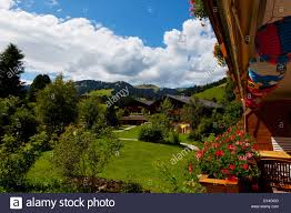 chalet houses in switzerland stock photo royalty free image