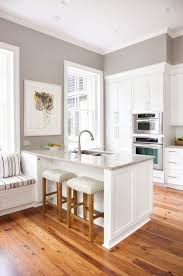 grey walls with cream cabinets and natural hardwood floors